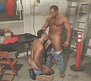 Big muscle men in hardcore action in garage